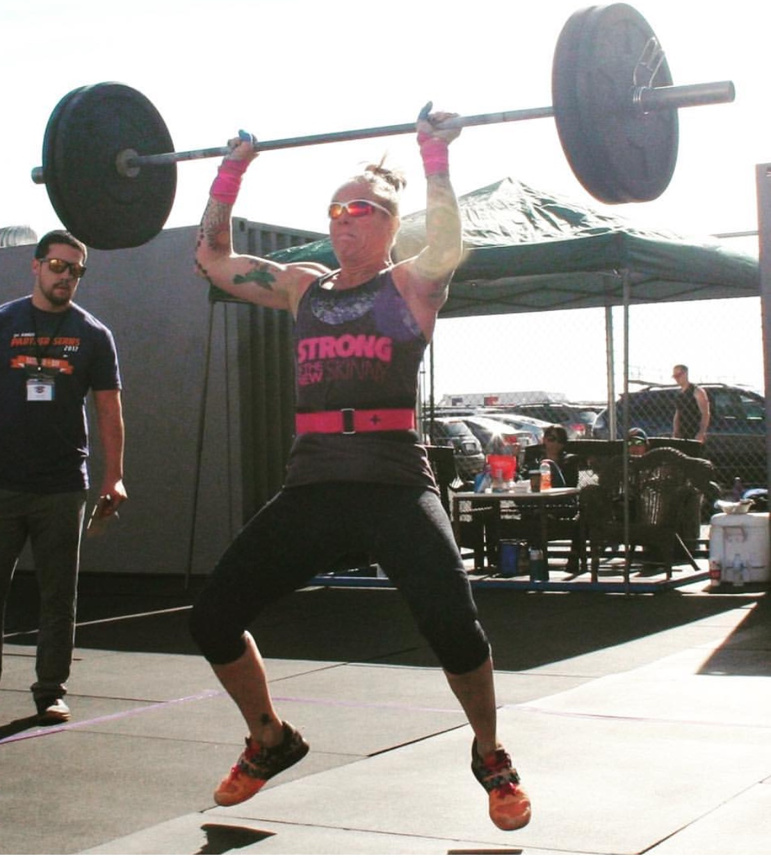 Jennifer doing an olympic lifting move as a master's athlete during a competition